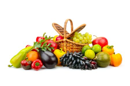 Bright fruits and vegetables in willow basket isolated on white background