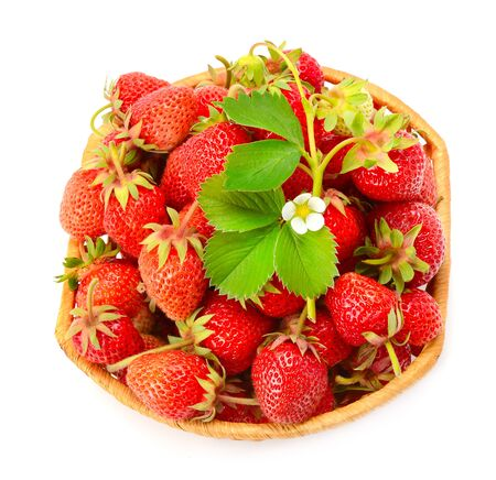 Basket with sweet ripe strawberries isolated on white background. Top view
