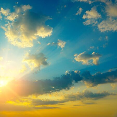 Epic sky landscape with bright sun behind dark fantastically clouds Stock Photo