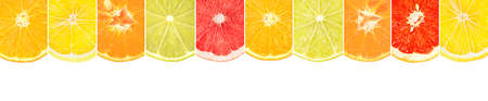 Halves of citrus fruits separated by vertical lines isolated on white background. Stock Photo