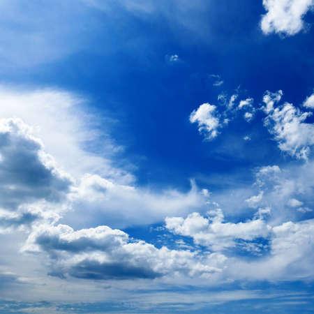 Beautiful white clouds on dark blue sky. Stock Photo