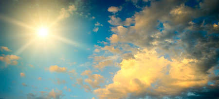 Panoramic epic sky landscape with bright sun and fantastically beautiful clouds.