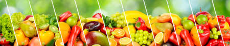 Large panoramic collection fruits, vegetables and berries separated by sloping lines on green blurred natural background. Stock Photo