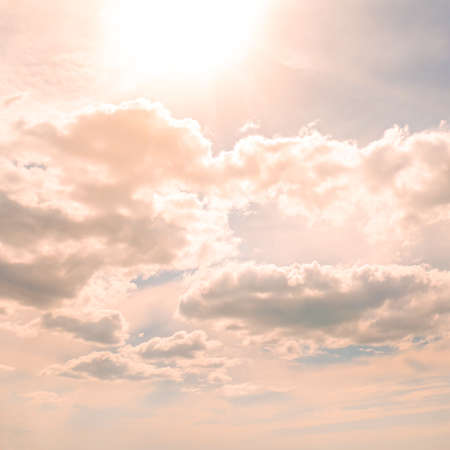 Summer sun in sky with white clouds.