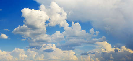 Beautiful white clouds on bright blue sky Stock Photo