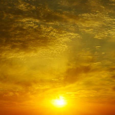 Golden sunset in bright sky. Foto de archivo
