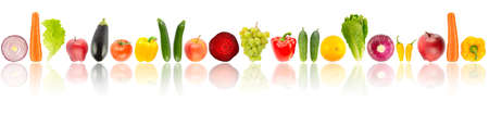 Fresh fruits and vegetables arranged in one row with light reflection isolated on white background.