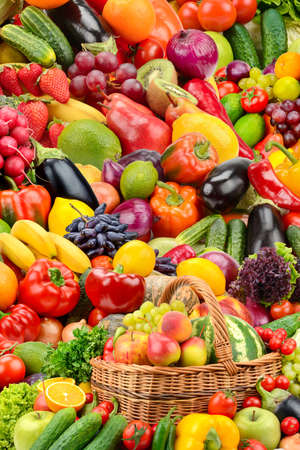 Vertical background from bright fresh healthy vegetables, fruits and berries.