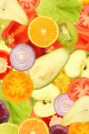 Vertical background from bright fresh vegetables, fruits and berries.