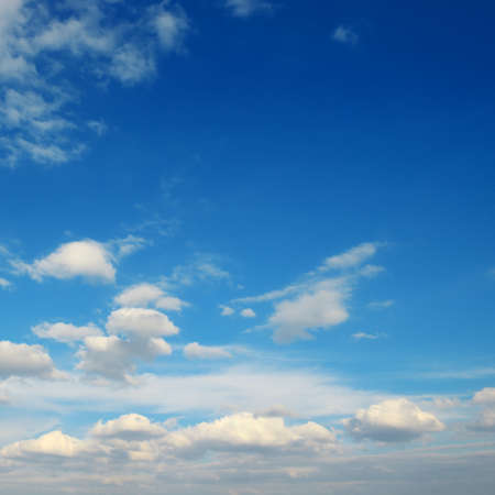 White fluffy clouds against bright azure sky. 版權商用圖片