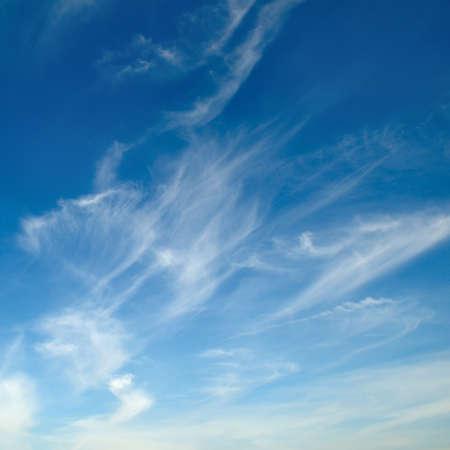 White fluffy clouds on blue sky. 版權商用圖片