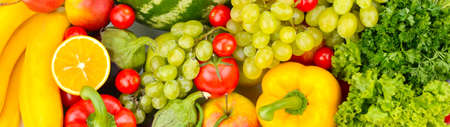 Panoramic shot of vegetables and fruits. Top view.