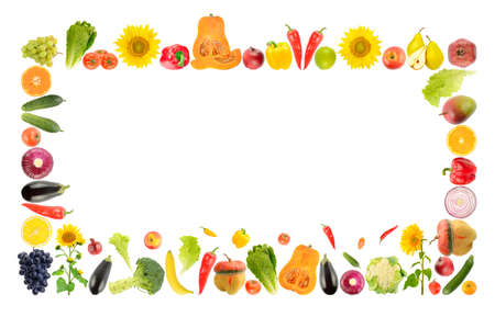 Large bright frame of fresh vegetables and fruits isolated on white background.