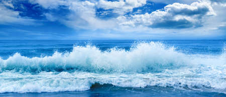 Bright ocean panoramic landscape in blue tones. Sea waves and beautiful sky with white clouds. 版權商用圖片