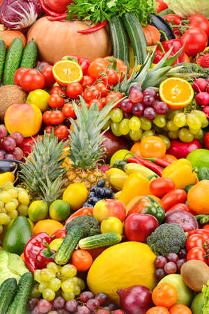 Vertical background from fresh healthy vegetables, fruits and berries.