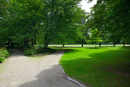 Gravel path for sports and walking in beautiful public summer park. 版權商用圖片