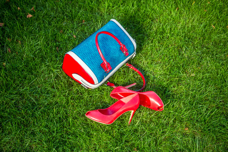 Shoes and womens handbag lay on the grass, womens shoes photo