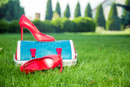 Womens shoes are on the bag and on the ground, womens summer shoes photo