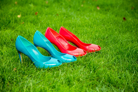 womens shoes in a row standing position on the grass photo