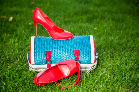 lined up: Womens shoes are on the bag and on the ground, womens summer shoes