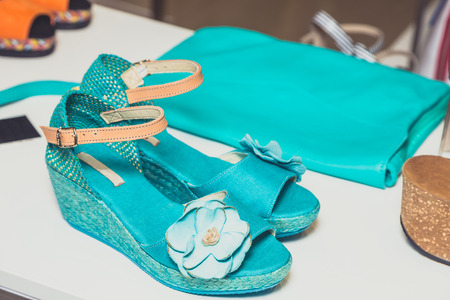 turquoise sandals and handbag photo