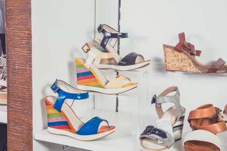 Sandals stand on a shelf photo