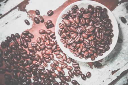 crumble coffee beans on a plate Фото со стока