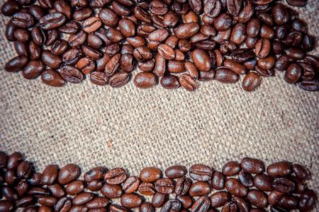 background of coffee on sackcloth Фото со стока