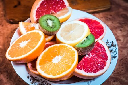 sliced fruit: fruit salad, sliced fruit, kiwi, orange, lemon, grapefruit