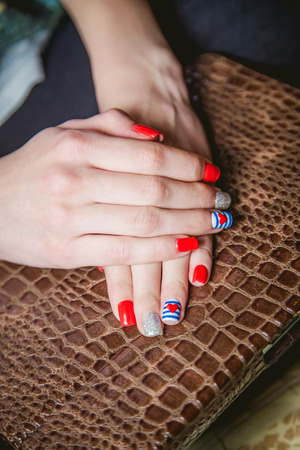 painted toes: manicure on background alligator Stock Photo