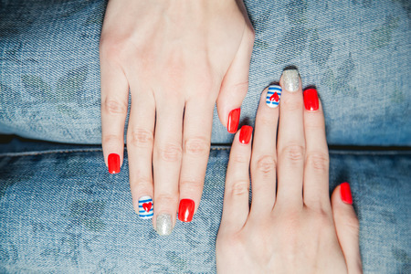 painted toes: girl shows stylish manicure Stock Photo