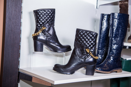 leather boots: Black leather boots with gold chain Stock Photo