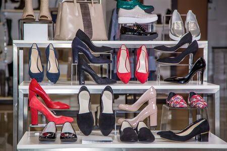 Large selection of women's shoes on the shelf in the store