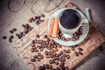 espreso: fragrant coffee on a notebook, espresso cup and saucer