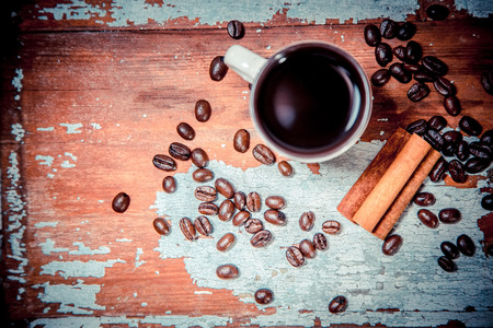 espreso: fragrant coffee on a wooden background, espresso cup and saucer