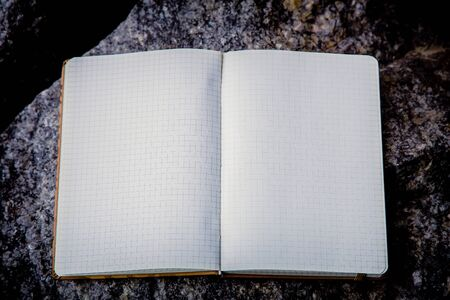 entries: Entries in a notebook, net notebook on a granite stone a