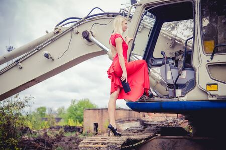 penetrating: The blonde in a red dress on the excavator, beauty fashion