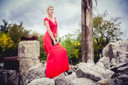 penetrating: The blonde in a red dress, loose material Stock Photo