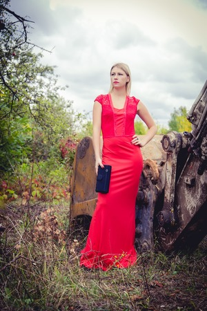 The blonde in a red dress, loose material Stock Photo