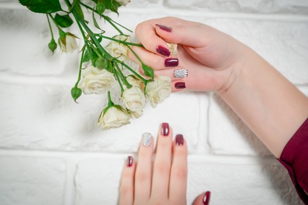 nails: Red nails, shell on the nail Stock Photo