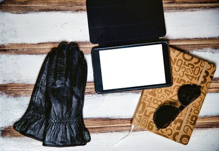 leather gloves: mens accessories, sunglasses plate and leather gloves, the idea Stock Photo