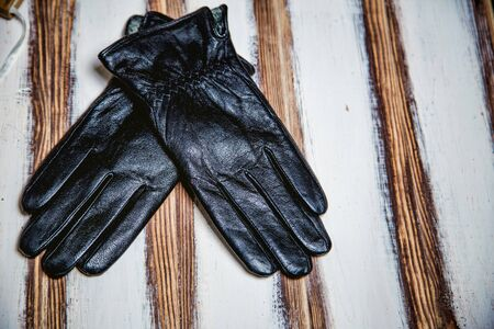 men's: Black mens gloves on wooden background idea