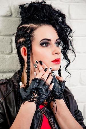 plaits: vinnitsa, UKRAINE - November 13, 2015.  Sexy brunette girl, makeup and hair in a beauty salon Stock Photo