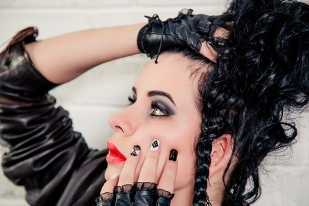 punk hair: Sexy brunette girl, makeup and hair in a beauty salon Stock Photo