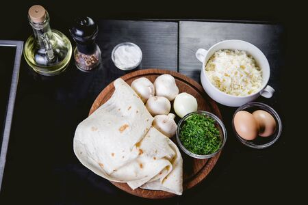 pita bread: mushrooms, pita bread, herbs, spices, ingredients for the rolls Stock Photo