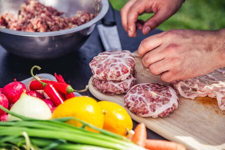 taste: cook burgers to barbecue, burger patties taste Stock Photo