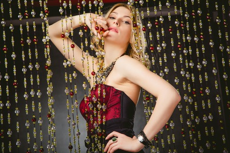 red corset: fashion photography girl in a crimson evening dress