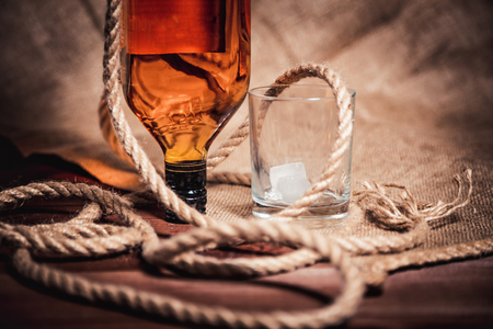 bourbon: bourbon whiskey rum in a glass with ice