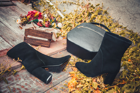 suede: black suede boots and female bag autumn Stock Photo
