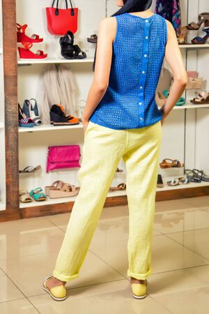 stylishly: stylish girl in a clothing store, a girl in pants Stock Photo